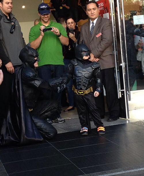 Batkid poses for a photo outside of Macy's in San Francisco's Union Square on November 15, 2013.