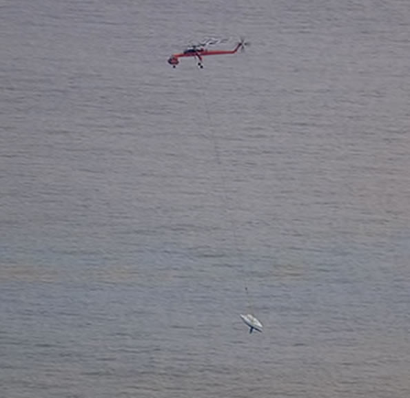 "<div class=""meta image-caption""><div class=""origin-logo origin-image ""><span></span></div><span class=""caption-text"">A large sky crane flew out to retrieve the Low Speed Chase yacht from The Farallones.</span></div>"