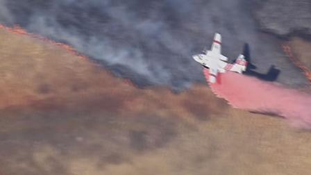 A large grass fire burning in Morgan Hill is threatening homes on  the east side of the city.