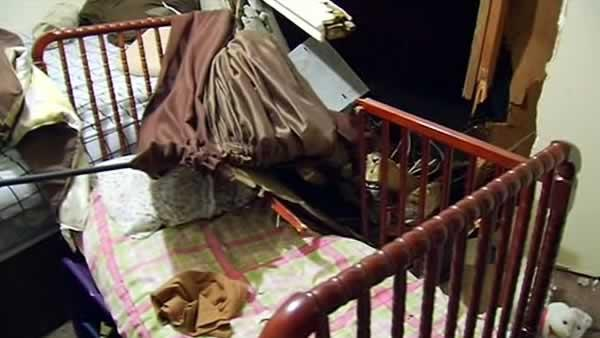 2-year-old unharmed after truck crashes into crib