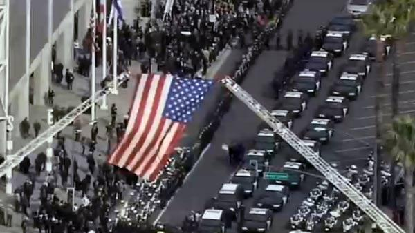 American flag flies outside HP Pavilion before start of the memorial.