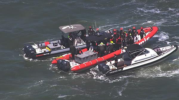 Emergency crews respond after America's Cup racing boat capsized on the Bay