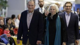 Merrill Newman, left, walks beside his wife Lee and son Jeffrey after arriving at San Francisco International Airport, Saturday, Dec. 6, 2013, in San Francisco