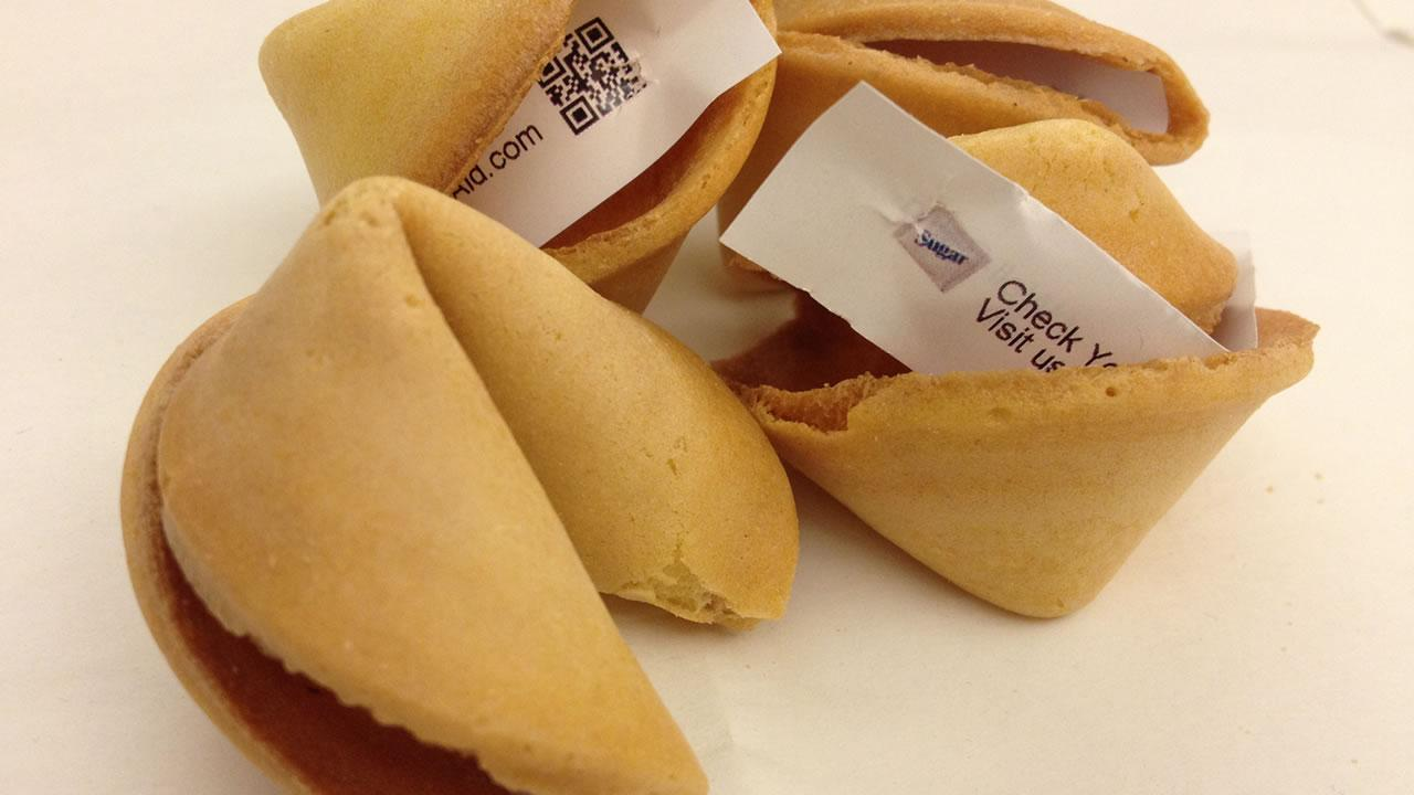 This undated photo provided by Fortune Cookie Advertising shows the companys prints advertisements on the back of the paper slips that are found inside fortune cookies. (AP Photo/Fortune Cookie Advertising)