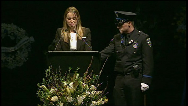 Sgt. Butch Baker&#39;s daughter Jillian Baker speaking at Santa Cruz officers&#39; memorial. <span class=meta>(Sgt. Butch Baker&#39;s daughter Jillian Baker speaking at Santa Cruz officers&#39; memorial.)</span>