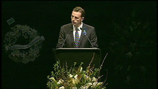 Santa Cruz County Supervisor Zach Friend speaks at memorial for two fallen Santa Cruz officers