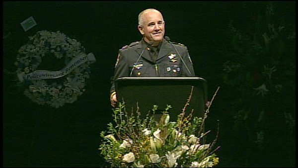 "<div class=""meta ""><span class=""caption-text "">Santa Cruz Deputy Police Chief Steve Clark eulogizing Det. Sgt. Butch Baker (KGO)</span></div>"