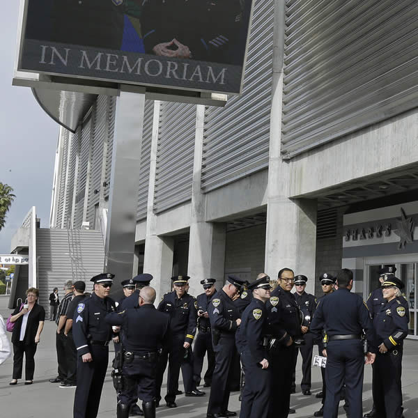 Law enforcement personnel gather outside HP Pavilion where a memorial service is to be held in honor of slain Santa Cruz police Sgt. Loran Baker and detective Elizabeth Butler Thursday, March 7, 2013, in San Jose, Calif. Baker and Butler were shot to death on Feb. 27, after arriving at the home of Jeremy Peter Goulet to question him about a misdemeanor sexual assault. (AP Photo/Ben Margot)