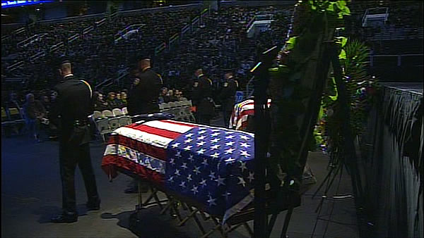 "<div class=""meta ""><span class=""caption-text "">The caskets of slain Santa Cruz police Sgt. Loran Baker and detective Elizabeth Butler lie at a memorial service Thursday, March 7, 2013, at HP Pavilion in San Jose, Calif. Baker and Butler were shot to death on Feb. 27, after arriving at the home of Jeremy Peter Goulet to question him about a misdemeanor sexual assault. (AP Photo/Ben Margot)</span></div>"