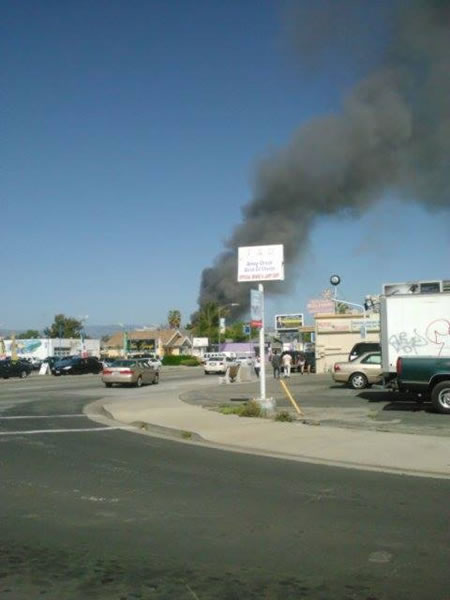 Crews battle a multi-alarm fire at a commercial structure at Park Avenue and S. Montgomery Street in San Jose. (Photo submitted by Melissa via Facebook)
