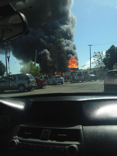 Crews battle a multi-alarm fire at a commercial structure at Park Avenue and S. Montgomery Street in San Jose. (Photo submitted via uReport)