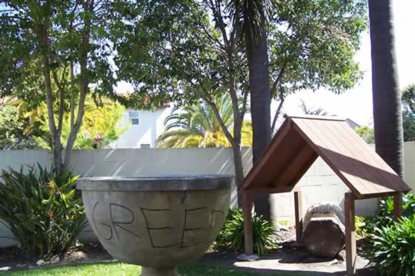 "<div class=""meta image-caption""><div class=""origin-logo origin-image ""><span></span></div><span class=""caption-text"">Police are investigating extensive vandalism that took place May 6, 2012 at historic Holy Cross Church in Santa Cruz.</span></div>"