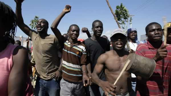 Earthquake survivors chant during a demonstration in Port-au-Prince, Wednesday, Feb. 3, 2010.