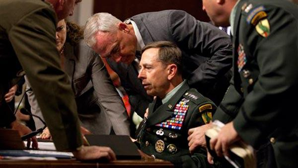 U.S. Central Commander Gen. David Petraeus is surrounded by staff after appearing to pass out on Capitol Hill in W