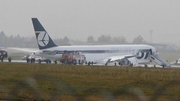 Plane from US lands on belly in Poland, none hurt