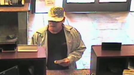 Serial bank robber turns himself into police.