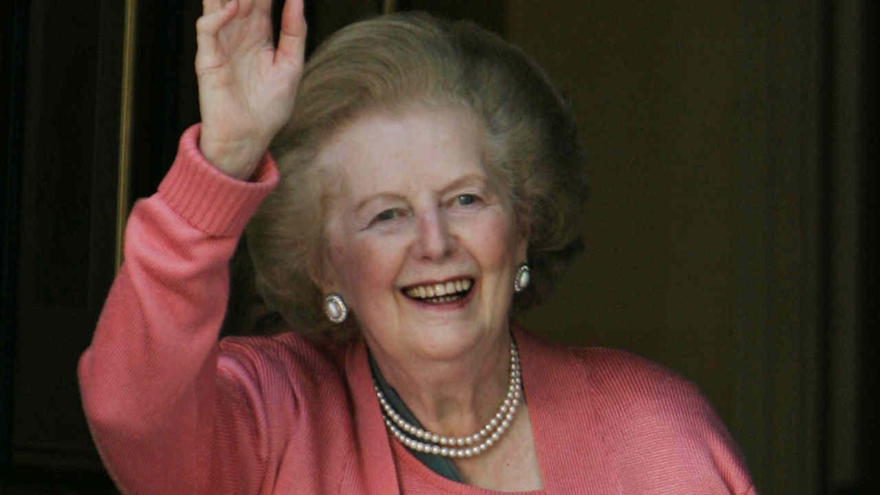 FILE -- Former British Prime Minister Margaret Thatcher, gestures to members of the media as she stands on her house doorstep, following her return home from hospital, in central London, Monday June 29, 2009.