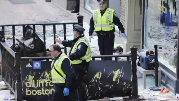 Boston police clear an area following an explosion near the finish line of the 2013 Boston Marathon in Boston. (AP Photo/Charles Krupa)