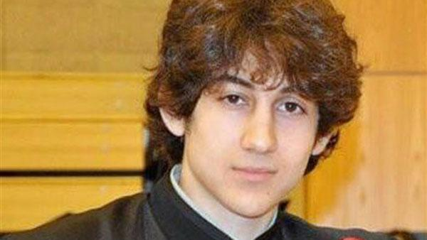 In this undated photo provided by Robin Young, Dzhokhar A. Tsarnaev, poses for a photo after graduating from Cambridge Rindge and Latin High School. Tsarnaev has been identified as the surviving suspect in the marathon bombings.