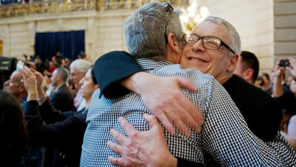 Cleve Jones embracing a friend while celebrating Wednesday's historic SCOTUS decision at City Hall in San Francisco.