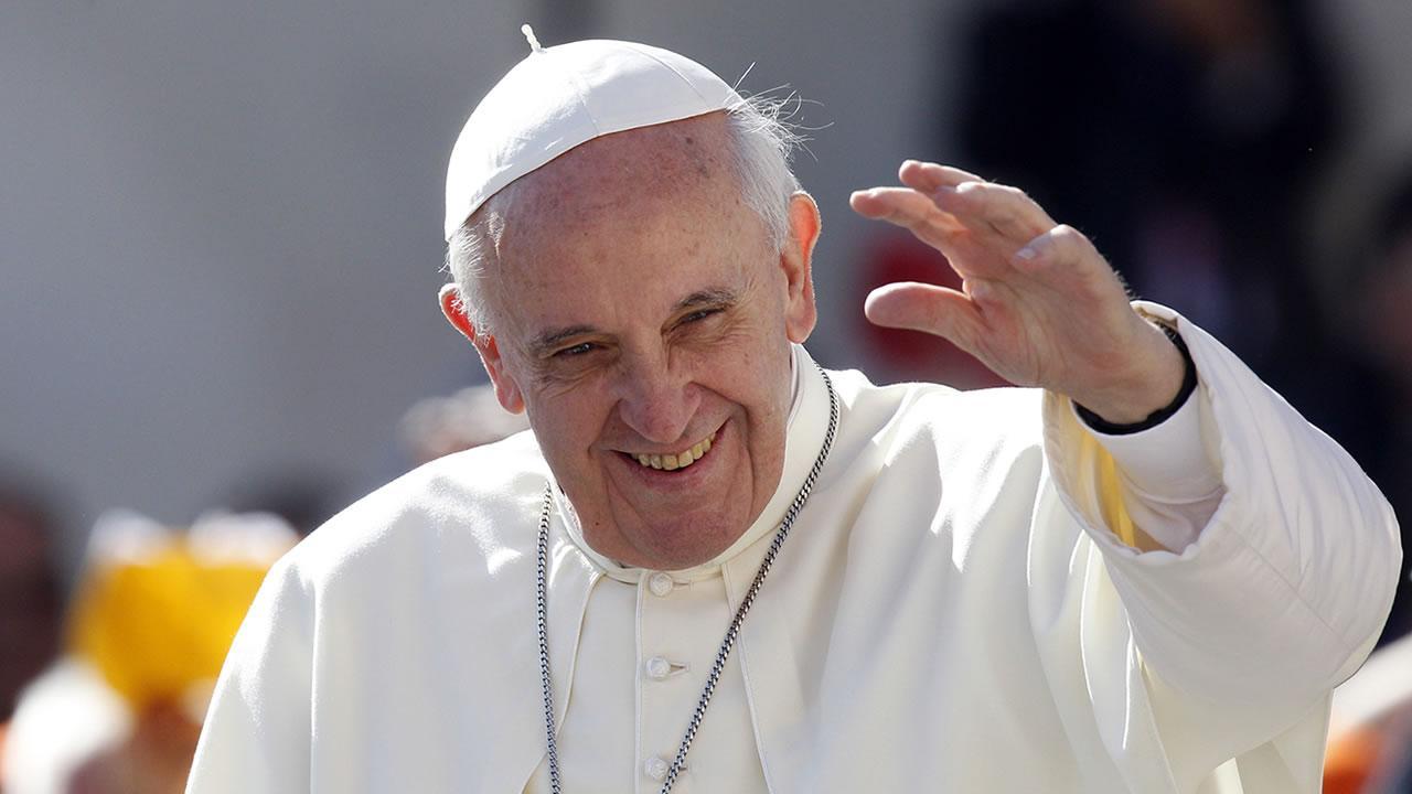Pope Francis waves to faithful as he arrives for his weekly general audience in St. Peters Square at the Vatican, Wednesday, Sept. 18, 2013. (AP Photo/Riccardo De Luca)
