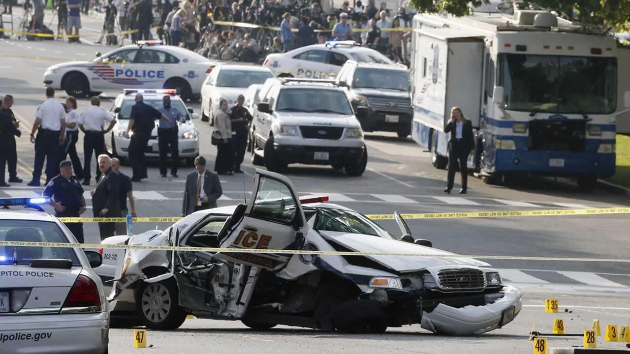 A wrecked Capitol Police car blocks Constitution Avenue NW following a shooting on Capitol Hill in Washington