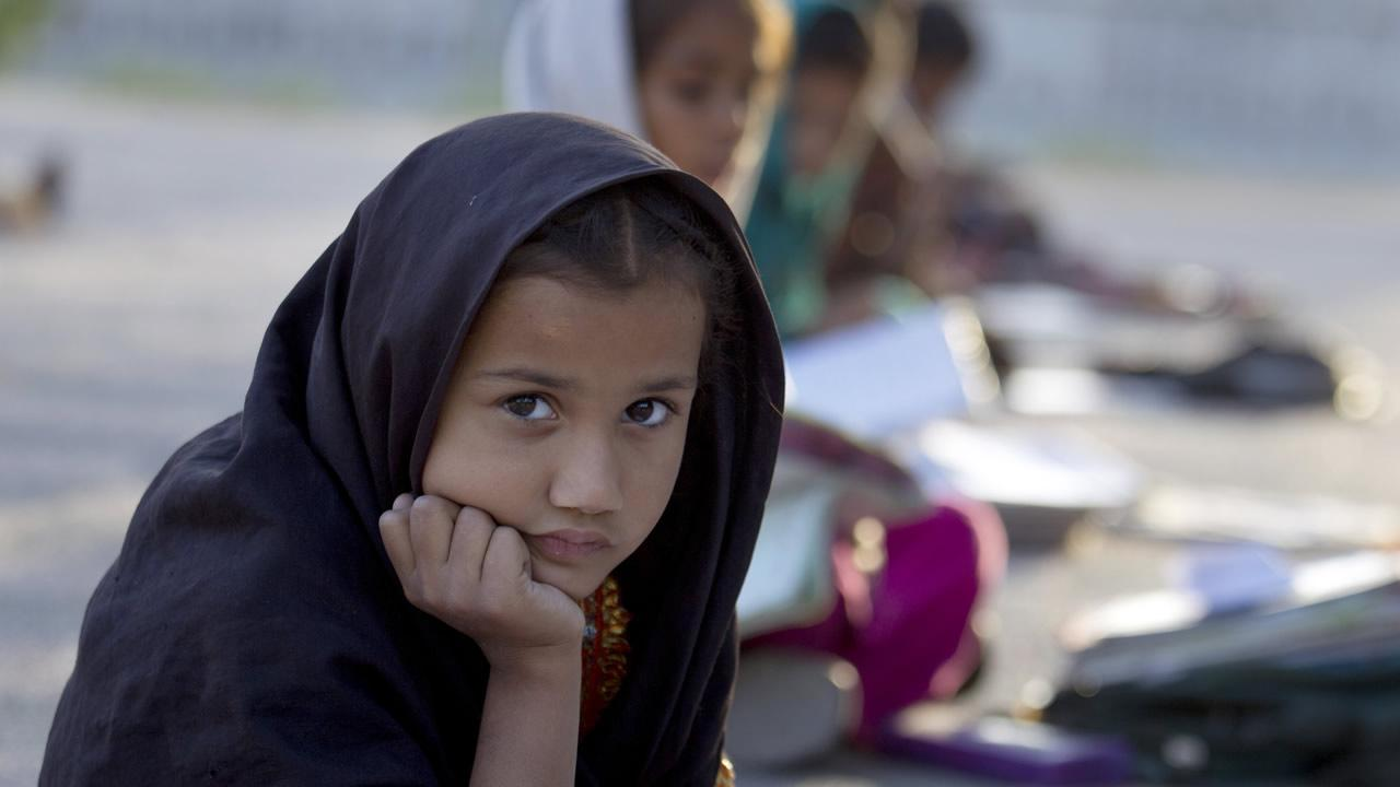 Pakistani student Farah Muneeb from Islamabads slums sits with fellow students at a makeshift school set up by a volunteer in a park in Islamabad, Pakistan on Thursday, Oct 11, 2012.