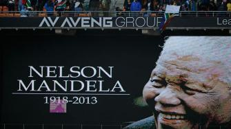 An image of former South African president Nelson Mandela is projected on a screen at the FNB Stadium in Soweto, near Johannesburg, South Africa, ahead of his memorial service Tuesday Dec. 10, 2013.