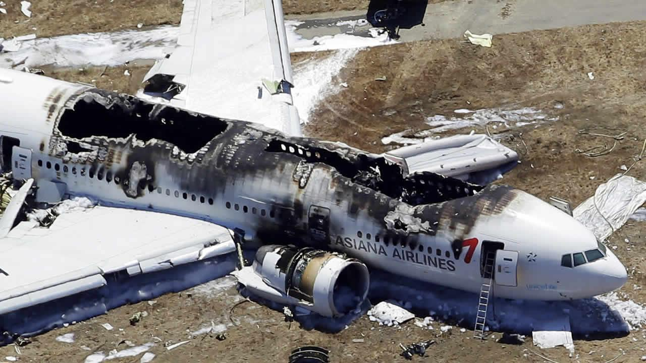FILE - This July 6, 2013, file photo, shows the wreckage of the Asiana Flight 214 airplane after it crashed at the San Francisco International Airport in San Francisco