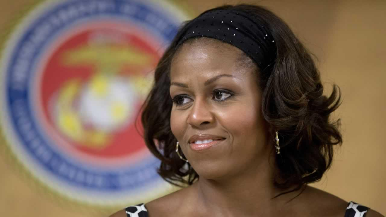 First lady Michelle Obama looks out from the stage as President Barack Obama speaks to members of the military and their families in Anderson Hall at Marine Corps Base Hawaii, Wednesday, Dec. 25, 2013, in Kaneohe Bay, Hawaii.