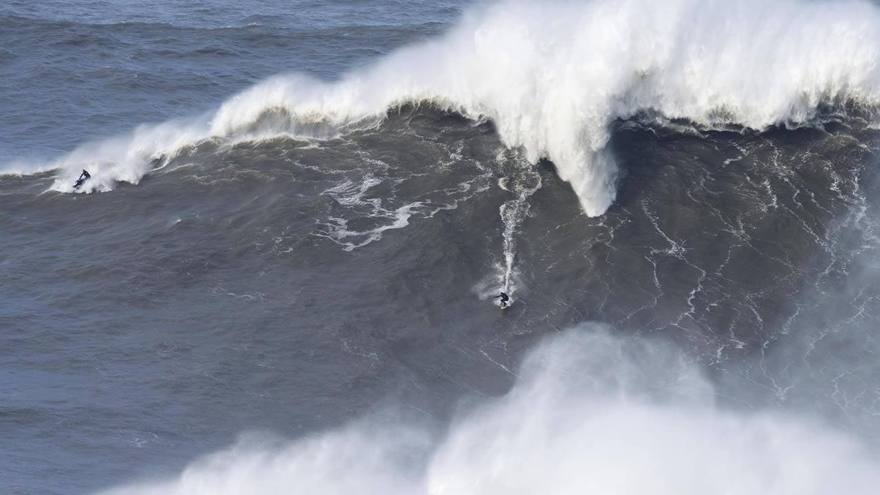US surfer Garret McNamara rides a giant wave at Praia do Norte, north beach, in Nazare, in Portugals Atlantic coast Sunday, Feb. 2 2014