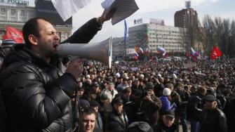 People shout slogans during a pro Russian rally at a central square in Donetsk, eastern Ukraine, Sunday, March 9, 2014