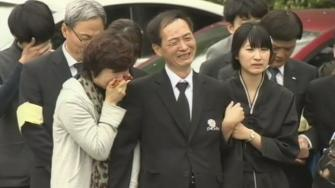 Family of South Korea ferry disaster victim cries.