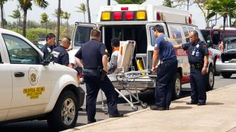 A 16-year-old boy who stowed away in the wheel well of a flight from San Jose, Calif., to Maui is loaded into an ambulance at Kahului Airport on Sunday afternoon.