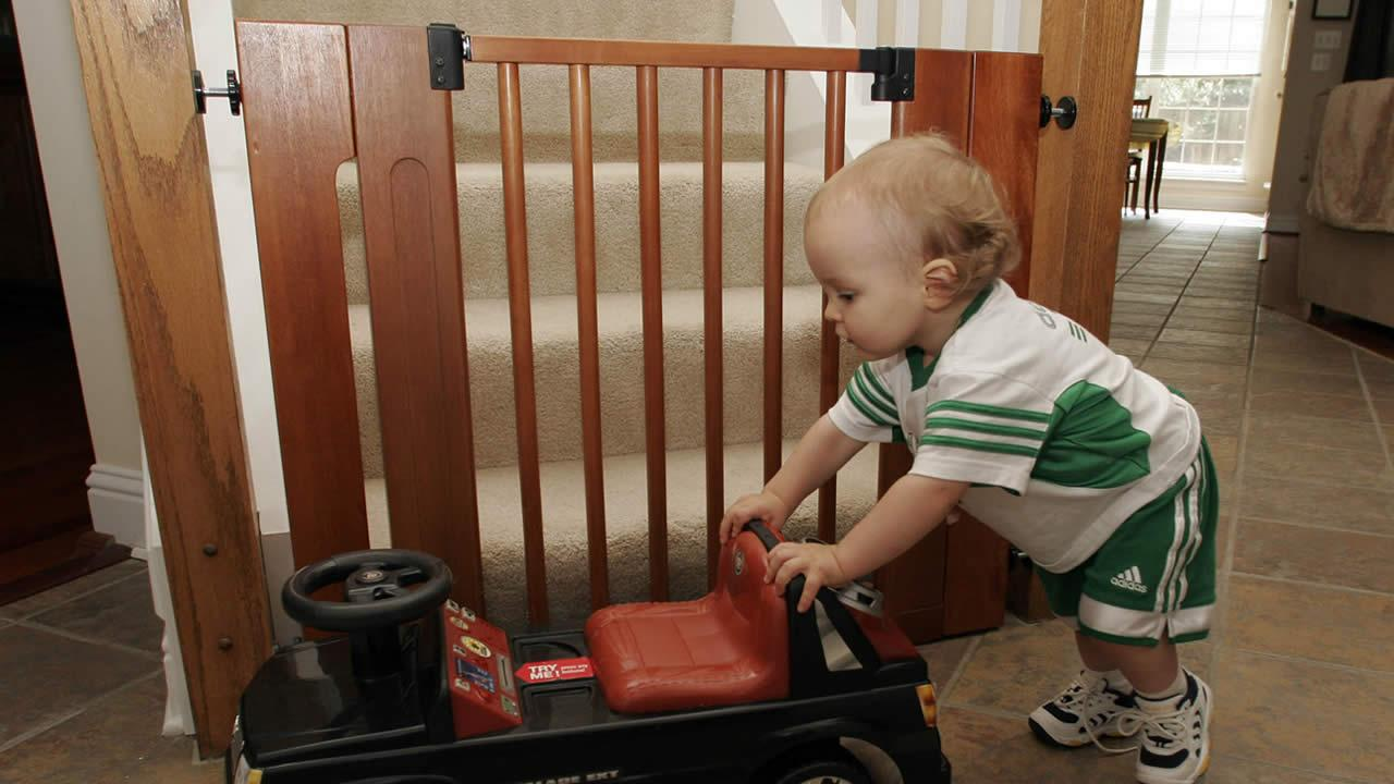 Erin Streets 15-month-old son Nate, plays with a toy by a baby gate on the stairs, Thursday Aug. 2, 2007, at their home in Hoover, Ala. (AP Photo/Butch Dill)