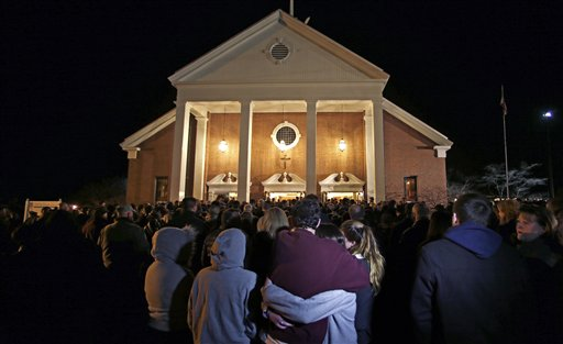 As hundreds stand outside St. Rose of Lima Roman Catholic Church, which was filled to capacity, a couple embrace during a healing service held in for victims of an elementary school shooting in Newtown, Conn., Friday, Dec. 14, 2012. A gunman opened fire at Sandy Hook Elementary School in Newtown, killing 26 people, including 20 children. <span class=meta>(AP Photo&#47;Charles Krupa)</span>