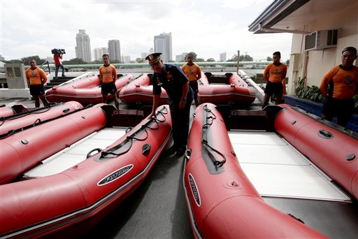 Philippine Coast Guard Chief Rear Adm. Rodolfo Isorena checks newly-acquired rubber boats following blessing ceremony Wednesday, Nov. 6, 2013 in Manila, Philippines. Isorena said the new single-hull aluminum boats and rubber boats will be deployed to central Philippines in preparation for the onslaught of super typhoon &#34;Haiyan&#34; which is expected to make a landfall in central Philippines this weekend. <span class=meta>(AP Photo&#47;Bullit Marquez)</span>