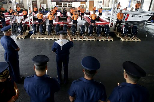 "<div class=""meta ""><span class=""caption-text "">Philippine Coast Guard Chief Rear Adm. Rodolfo Isorena, left, witnesses the blessing of newly-acquired rubber boats following blessing ceremony Wednesday, Nov. 6, 2013 in Manila, Philippines. Isorena said the new single-hull aluminum boats and rubber boats will be deployed to central Philippines in preparation for the onslaught of super typhoon Haiyan which is expected to make a landfall in central Philippines this weekend. (AP Photo/Bullit Marquez)</span></div>"
