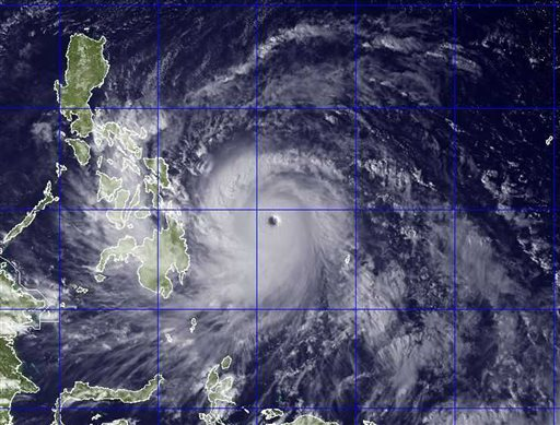 "<div class=""meta ""><span class=""caption-text "">This image provided by the U.S. Naval Research Lab shows Typhoon Haiyan taken by the NEXSAT satellite Thursday Nov. 7, 2013 at 2:30 a.m. EDT. Gorvernment forecasters said Thursday that Typhoon Haiyan was packing sustained winds of 215 kilometers (134 miles) per hour and ferocious gusts of 250 kph (155 mph) and could pick up strength over the Pacific Ocean before it slams into the eastern Philippine province of Eastern Samar on Friday. (AP Photo/US Naval Research Lab)</span></div>"