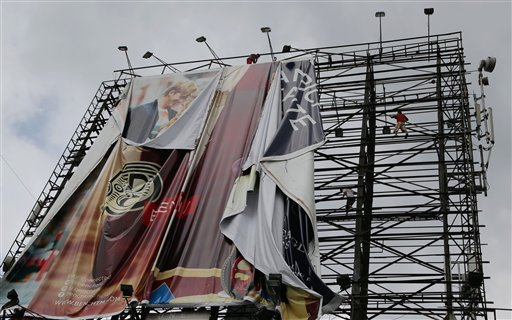 Filipino workers bring down a giant billboard along a busy highway as they prepare for the possible effects of powerful Typhoon Haiyan in suburban Makati, south of Manila, Philippines Thursday, Nov. 7, 2013. Philippine officials say thousands of villagers, including those from a central province devastated recently by an earthquake, are being evacuated ahead of the arrival of one of Asia&#39;s most powerful typhoons this year.  <span class=meta>(AP Photo&#47;Aaron Favila)</span>