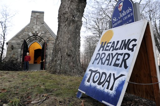A sign for a Healing Prayer stands outside St. John&#39;s Episcopal Church near the scene of a school shooting in Newtown, Conn., Friday, Dec. 14, 2012. A man opened fire Friday inside two classrooms at the school where his mother worked as a teacher, killing 26 people, including 20 children. The killer, armed with two handguns, committed suicide at the school and another person was found dead at a second scene, bringing the toll to 28, authorities said. A law enforcement official identified the gunman as 20-year-old Adam Lanza. <span class=meta>(AP Photo&#47;Jessica Hill)</span>