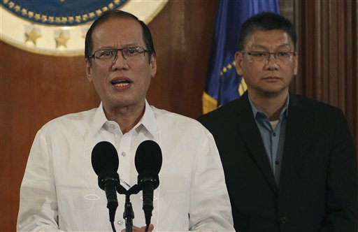 In this photo released by the Malacanang Photo Bureau, Philippine President Benigno Aquino III, left, speaks about Typhoon Haiyan during a nationally televised address at the Malacanang palace in Manila, Philippines on Thursday Nov. 7, 2013. Thousands of people evacuated villages in the central Philippines on Thursday before one of the year&#39;s strongest typhoons strikes the region, including a province devastated by an earthquake last month. Standing at right is Executive Secretary Paquito Ochoa Jr. <span class=meta>(AP Photo&#47;Malacanang Photo Bureau, Robert Vinas)</span>