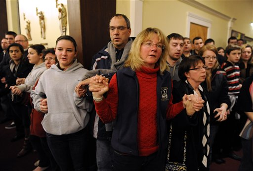 "<div class=""meta ""><span class=""caption-text "">Mourners gather inside the St. Rose of Lima Roman Catholic Church at a vigil service for victims of the Sandy Hook Elementary School shooting that left at least 27 people dead, many of them young children, in Newtown, Conn. Friday, Dec. 14, 2012. Police have identified the gunman as Adam Lanza, whose mother was a teacher at the school. (AP Photo/Andrew Gombert, Pool)</span></div>"