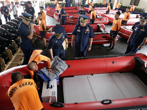 "<div class=""meta ""><span class=""caption-text "">Philippine Coast Guard Chief Rear Adm. Rodolfo Isorena checks newly-acquired rubber boats following blessing ceremony Wednesday, Nov. 6, 2013 in Manila, Philippines. Isorena said the new single-hull aluminum boats and rubber boats will be deployed to central Philippines in preparation for the onslaught of super typhoon ""Haiyan"" which is expected to make a landfall in central Philippines this weekend. (AP Photo/Bullit Marquez)</span></div>"