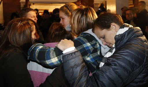 Girls embraces outside St. Rose of Lima Roman Catholic Church, which was filled to capacity, during a healing service held in for victims of an elementary school shooting in Newtown, Conn., Friday, Dec. 14, 2012. A gunman opened fire at Sandy Hook Elementary School in Newtown, killing 26 people, including 20 children. <span class=meta>(AP Photo&#47;Charles Krupa)</span>