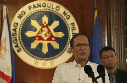 In this photo released by the Malacanang Photo Bureau, Philippine President Benigno Aquino III speaks about Typhoon Haiyan during a nationally televised address at the Malacanang palace in Manila, Philippines on Thursday Nov. 7, 2013. Thousands of people evacuated villages in the central Philippines on Thursday before one of the year&#39;s strongest typhoons strikes the region, including a province devastated by an earthquake last month. Standing at right is Executive Secretary Paquito Ochoa Jr.  <span class=meta>(AP Photo&#47;Malacanang Photo Bureau, Robert Vinas)</span>