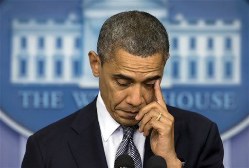 President Barack Obama wipes his eye as he talks about the Connecticut elementary school shooting, Friday, Dec. 14, 2012, in the White House briefing room in Washington. <span class=meta>(AP Photo&#47;Carolyn Kaster)</span>