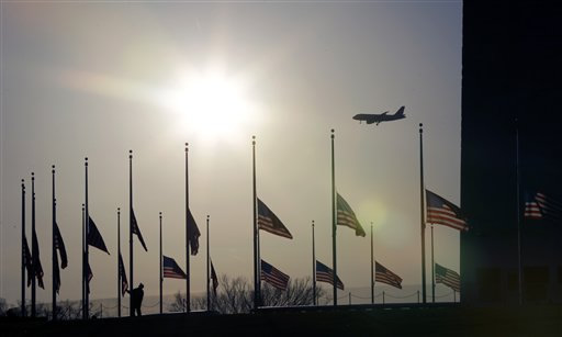 <span class=meta>(American flags surrounding the Washington Monument in Washington are lowered to half-staff in a mark of respect for the victims on the Connecticut elementary school shootings, Friday, Dec. 14, 2012.)</span>