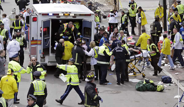 <span class=meta>(Medical workers aid injured people at the finish line of the 2013 Boston Marathon in Boston, Monday, April 15, 2013. &#40;AP Photo&#47;Charles Krupa&#41;)</span>
