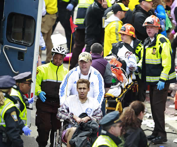 "<div class=""meta ""><span class=""caption-text "">Medical workers aid injured people at the finish line of the 2013 Boston Marathon following an explosion in Boston, Monday, April 15, 2013. Two explosions near the finish of the Boston Marathon on Monday, killing at least two people, injuring over 20 others. (AP Photo/Charles Krupa)</span></div>"